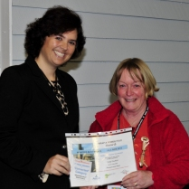 Mayor Sarah Schmerl presents 1st prize in the Connected category to Judy Duckett